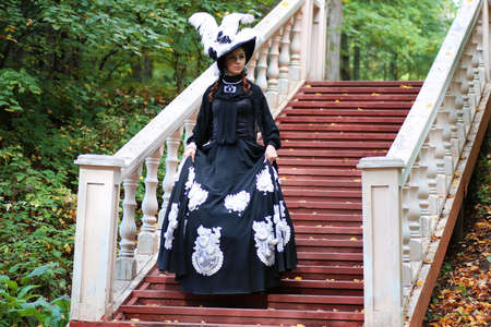 victorian girl: beautiful girl in Victorian dress in the manor summer day