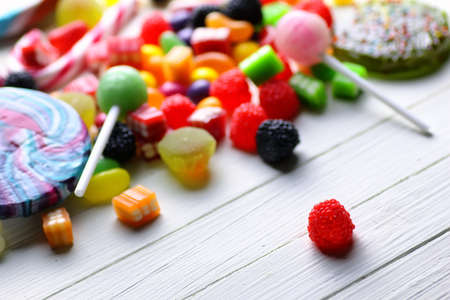 liquorice: various sweets candy colored jelly beans on a wooden background Stock Photo