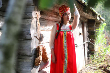 log basket: beautiful young girl in traditional red dress