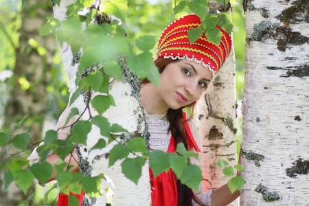 beautiful young girl in traditional red dress. Slavic culture Stock Photo