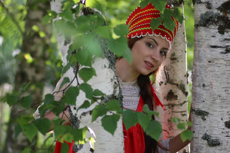 slavic: beautiful young girl in traditional red dress Slavic culture