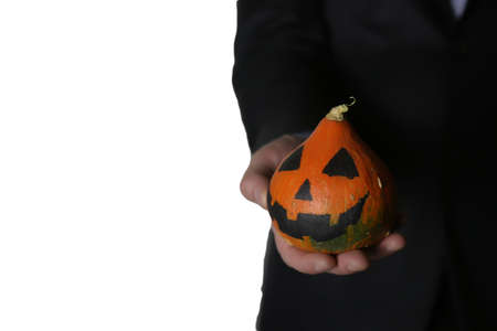 pumpkin head: man in suit with pumpkin head halloween concept