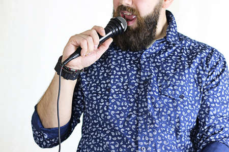 pop idol: close-up portrait of a handsome bearded man posing on camera Stock Photo