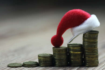 christmas profits: stack of coins new year