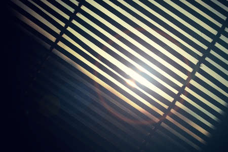 wood blinds: sun is shining through the wood blinds