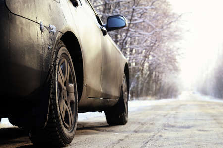 hoar: dark elements of car in the winter with hoar frost on them