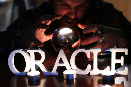 palmist: sorcerer hands over a transparent crystal ball fortune-telling for the future
