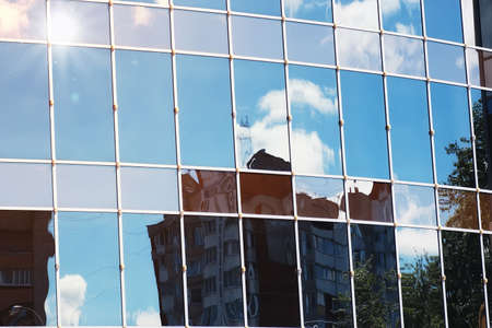 glass reflection: background glass office building windows with reflection of sky in them