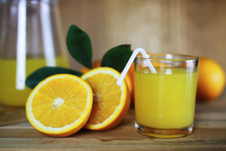 textural: Delicious fresh orange juice on a wooden textural background