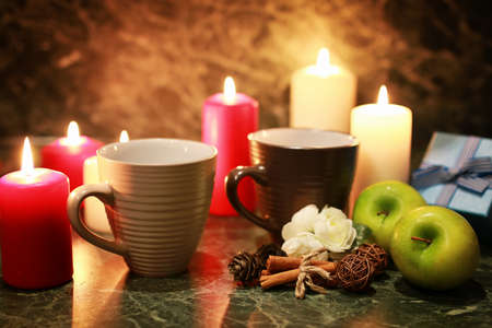 dining utensils Cup candles and sweets on the table of wood