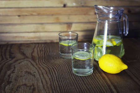 fragrant yellow slices of lemon in the water for cooking homemade lemonade
