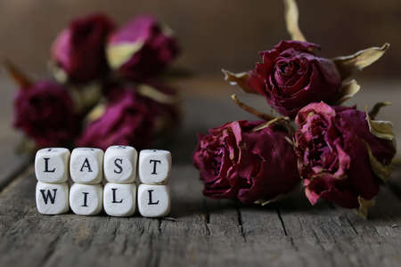 heir: small wooden blocks with letters on the old worn wooden table