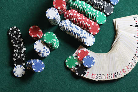 green felt on the poker table chips and cards ready to play