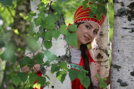 beautiful young girl in traditional red dress Slavic culture