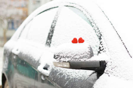 color in: Snowy day shape of hearts red color in winter day