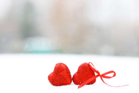 Snowy day shape of hearts red color in winter day