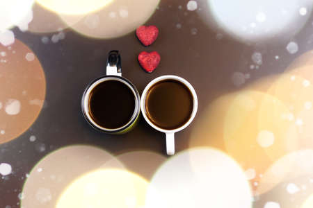 two lovers holding each others hands and drinking coffee at the table