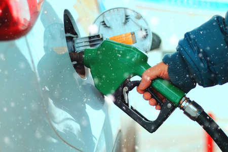 gun filling unit on the fuel tank filling inserted in the machine Standard-Bild