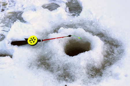 full of holes: Mens winter fun hike to the pond on the ice-fishing