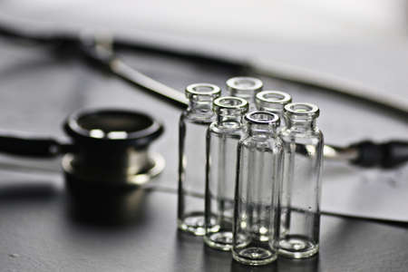 ampoules: medical ampoules and drugs to treat a variety of symptoms in the matte black table