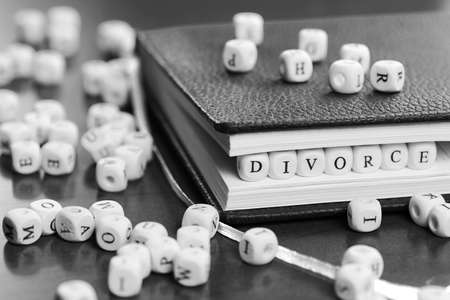 business ethics: small white wooden blocks made up the word in the table
