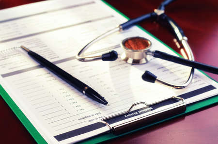 hospital expenses: Medical stethoscope and office tablet with a prescription for medicine