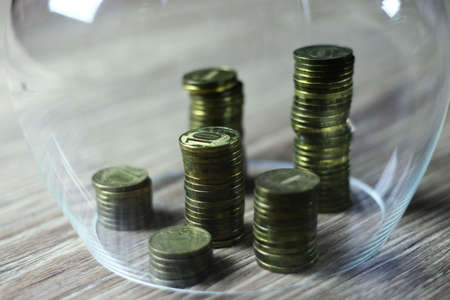 gradually: a lot of stacks of coins increasing yellow gradually the concept of progress and growth