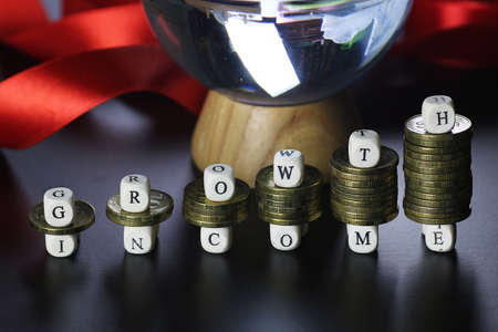 background for business small wooden letters and coins depict climbing up the stairs