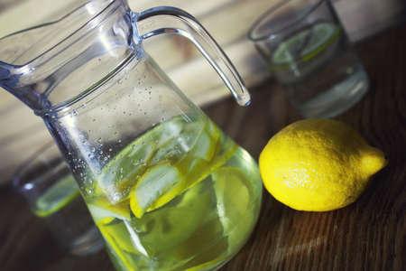 fragrant yellow slices of lemon in the water for cooking homemade lemonade