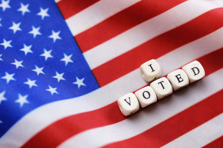 election simbol on usa flag with letter wooden cubes