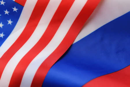 peace risk: russian usa flag sanctions wooden letters on them