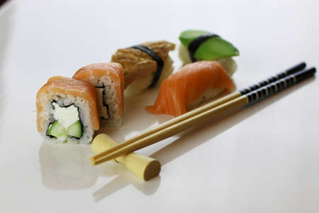 freshly prepared: a set of delicious freshly prepared bright and fragrant Japanese sushi and rolls on a white background