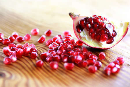 pomegranate seed on wood background Stock Photo