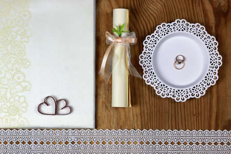 perl: wedding accessories and invitations to frame light wooden table Stock Photo