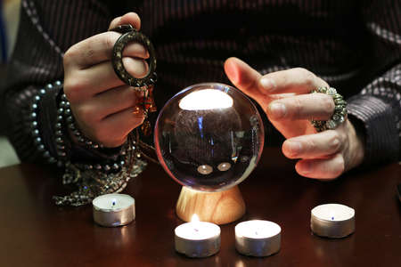astrologist: sorcerer hands over a transparent crystal ball fortune-telling for future