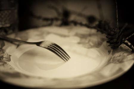 grunge cutlery: toned fork in plate monochrome