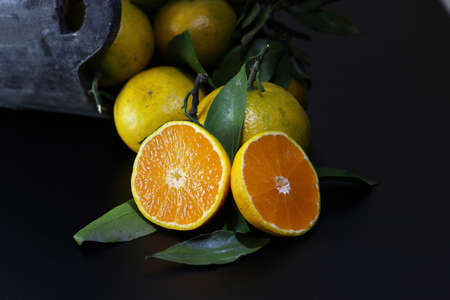 mandarin fruit isolate black Stock Photo