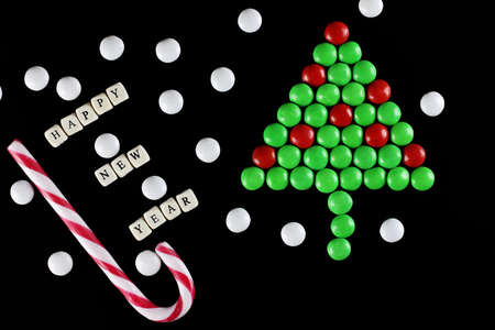 dragee: christmas tree shape candy background Stock Photo