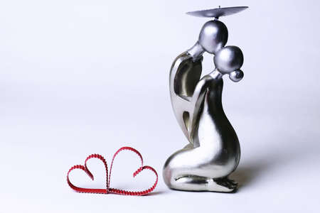 elegant silver metal figurines loving couple isolated on white background Stock Photo