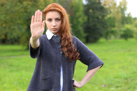pretty young woman posing on camera in autumn park Stock Photo