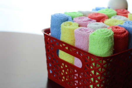 home set of multi-colored towels in a basket