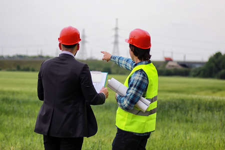 protective clothing: White worker in protective clothing and an orange helmet on workplace