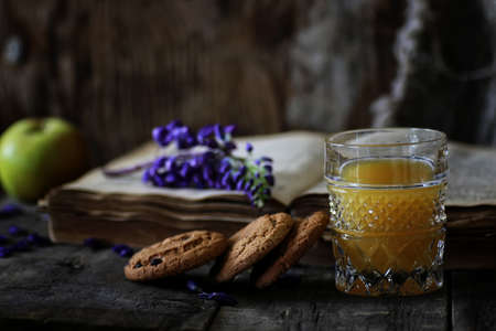 bible flower: retro book and glass of orange juice in morning Stock Photo