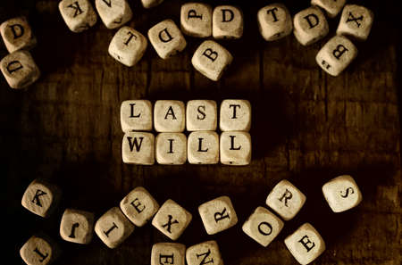 splotchy: small wooden blocks with letters on them are laid in the floor on the old wooden table