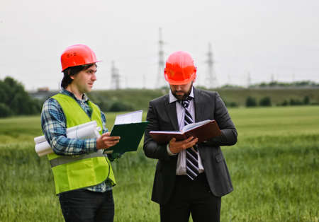 foreman: the working construction foreman in his place considering materials and work plan Stock Photo