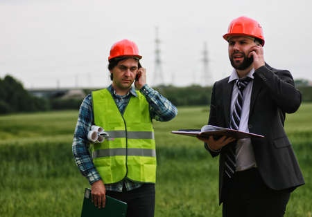 residential area: the working construction foreman in his place considering materials and work plan Stock Photo