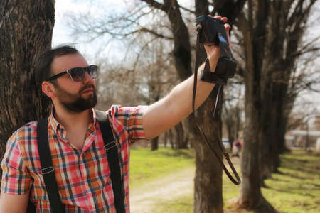 suspender: handsome and attractive person in the summer in the landscape of city streets and parks