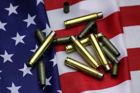 amendment: many shell casings from bullets of different caliber in the background chaos concept in the world Stock Photo