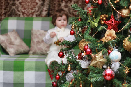 cute little kids on the floor in the interior of a childs room in the new year eve Stock Photo