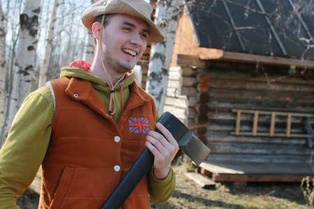 lumberjack shirt: man outdoor with axe in village in spring season